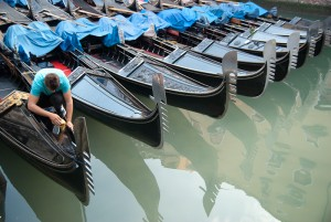 Gondolier preparing the boat for the day.